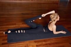 Beautiful woman yoga pilates gymnastics meditation Buddha Stock Photos