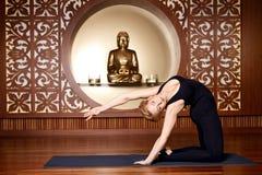 Beautiful woman yoga pilates gymnastics meditation Buddha Stock Image