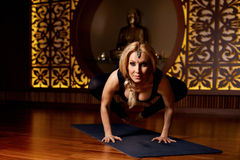 Beautiful woman yoga pilates gymnastics meditation Buddha Stock Photo