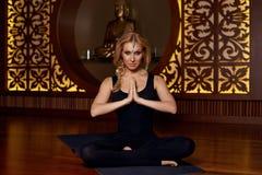 Beautiful woman yoga pilates gymnastics meditation Buddha Royalty Free Stock Photos