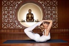 Beautiful woman yoga pilates gymnastics meditation Buddha Royalty Free Stock Photo