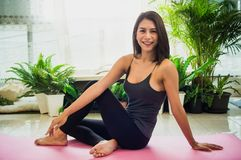 Beautiful women with yoga to refresh the mind and spirit, With sunlight morning, concept of relaxation and body and mind. Beautiful woman with yoga to refresh royalty free stock photos