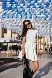 Beautiful woman young brunette wear in white dress Stock Images