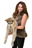 Beautiful woman with young dog Alaskan Malamute. Beautiful woman with young dog Malamute isolated on white royalty free stock image