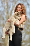 Beautiful woman with young dog Alaskan Malamute. Beautiful woman with young dog Malamute isolated on white stock image