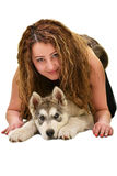 Beautiful woman with young dog Alaskan Malamute. Beautiful woman with young dog Malamute isolated on white royalty free stock photos