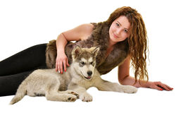 Beautiful woman with young dog Alaskan Malamute. Beautiful woman with young dog Malamute isolated on white stock photos