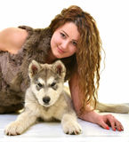 Beautiful woman with young dog Alaskan Malamute. Beautiful woman with young dog Malamute isolated on white stock photography