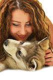 Beautiful woman with young dog Alaskan Malamute. Beautiful woman with young dog Malamute isolated on white stock images
