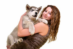 Beautiful woman with young dog Malamute Royalty Free Stock Photo
