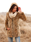 Beautiful woman. Beautiful young woman wearing a tigerprint coat and white scarf in the snow Royalty Free Stock Photography