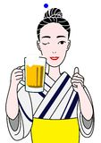 Beautiful woman in yukata with a beer mug. A yukata beauty ready to cheer Royalty Free Stock Photography