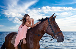 Beautiful womanl with horse on seacoast Royalty Free Stock Photos