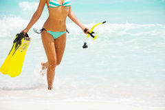 Beautiful womans body on beach background Royalty Free Stock Photo