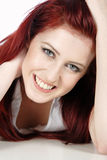 Beautiful womans face. Sexy womans face with long red hair smiling Stock Images