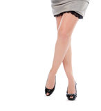 Beautiful womans legs in black shoes Stock Photo