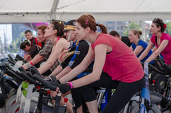 Beautiful womans at spinning class Stock Photos
