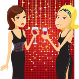 Beautiful women. In small black dresses drinking cocktails Stock Images