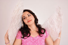 Beautiful women angel for Valentines. Beautiful and pretty woman dressed in angel costume with wings smiling seductively Stock Photography