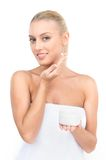 Beautiful women applying moisturizer cosmetic cream on face. Royalty Free Stock Photography