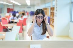 Beautiful women asian university student in library. Beautiful woman asian university student in library royalty free stock photos