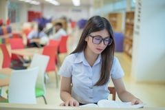 Beautiful women asian university student in library. Beautiful woman asian university student in library stock photography