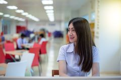 Beautiful women asian university student in library. Beautiful woman asian university student in library royalty free stock photo