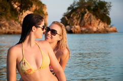Beautiful women in bikini standing in water stock images
