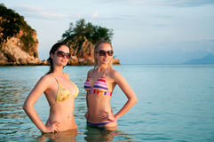 Beautiful women in bikini standing in water Royalty Free Stock Photos
