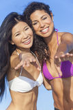 Beautiful Women In Bikinis Dancing on Sunny Beach Stock Image