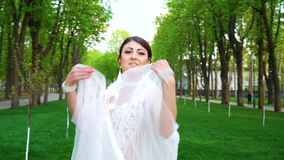 Beautiful women in bride styled costumes dance in sunny park. Young caucasian dancers perform outdoors in the open air. people, hobby and dance stock video