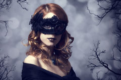 Beautiful women in carnival mask. Photo with forest at backgroun Royalty Free Stock Photography