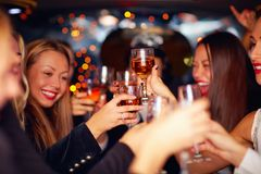 Beautiful women clinking glasses in limousine Royalty Free Stock Images