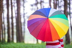 Beautiful women with colorful umbrella standing in autumn park a Stock Image