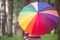 Beautiful women with colorful umbrella standing in autumn park a Royalty Free Stock Photos