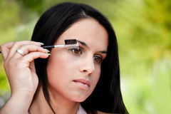 Beautiful women combing eye brows Stock Photo
