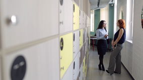 Beautiful women communicate and joke in off duty time at office stock video footage