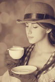 Beautiful women with cup of tea. Beautiful woman with cup of tea. Photo in retro style with bokeh at background Royalty Free Stock Images