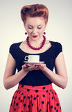 Beautiful women with cup of tea. Beautiful redhead woman with cup of tea. Photo in retro style Stock Images