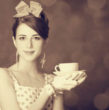 Beautiful women with cup of tea. Beautiful woman with cup of tea. Photo in retro style with bokeh at background Royalty Free Stock Photos