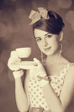 Beautiful women with cup of tea. Beautiful woman with cup of tea. Photo in retro style with bokeh at background Stock Photos