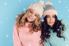 Beautiful women with curly hair  in winter clothes Royalty Free Stock Photography