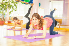 Beautiful women doing fitness exercise and looking at camera Stock Photos