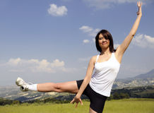 Beautiful women doing sports on the grass Royalty Free Stock Image