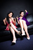 Beautiful women drinking and dancing Stock Photo