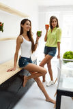 Beautiful Women Drinking Fresh Detox Juice For Healthy Nutrition Stock Photography