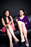 Beautiful women drinking at a party Royalty Free Stock Image