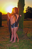 Beautiful women embrace in the setting sun Stock Photos