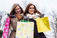 Beautiful women enjoying shopping together Royalty Free Stock Photo