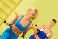 Beautiful women exercising. In fitness club stock image